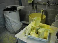 The ceramic station.  The yellow stuff is all the ceramic mixture and the barrel to the left is the sand.