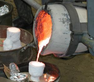 Pouring bronze into the final ceramic mold.