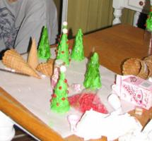 The beginnings of a forest of sugar trees.  Here we used red-hots to make a few into christmas trees.