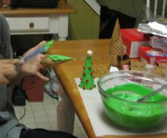 Spreading the frosting on the sugar cones to make trees.