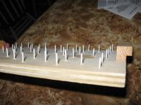 A simple board with nails driven into one side is perfect for a drying rack.